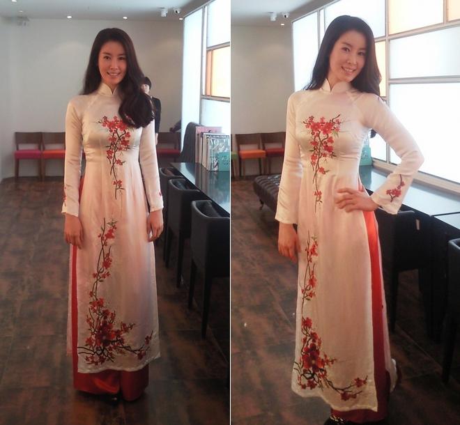 Ngắm các mỹ nhân thế giới đẹp dịu dàng trong tà áo dài Việt Nam - Ảnh 11.