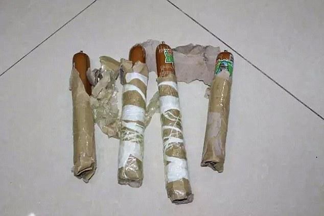 Chế 4 quả bom từ xúc xích, thanh niên cứng đe dọa cho nổ tung nhà bạn gái sau chia tay - ảnh 1