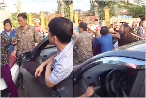 Người phụ nữ cởi áo, chửi lái xe ô tô như tát nước rồi xông vào đánh nhau vì bị nhắc nhở khi đứng giữa đường nghe điện thoại - Ảnh 3.