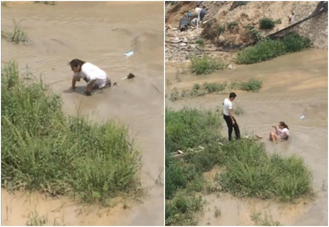 Cô gái trẻ quằn quại đòi nhảy sông tự tử ở vùng nước ngập chưa đến đầu gối - Ảnh 1.