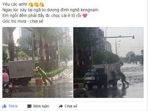 Hành động đẹp: Công an Hà Nội giúp tài xế đẩy chiếc xe tải bị chết máy trong trời mưa bão - Ảnh 1.