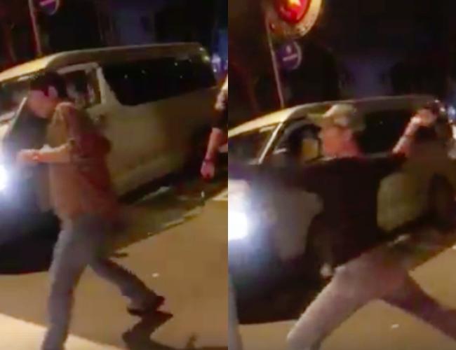 Cãi nhau sau va chạm giao thông, tài xế ô tô cầm rìu chém tới tấp vào lưng người đàn ông ở Sài Gòn - Ảnh 2.