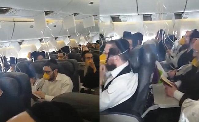 Máy bay gặp sự cố khẩn cấp, hành khách cùng đeo mặt nạ, đọc kinh và nắm tay cầu nguyện - Ảnh 2.