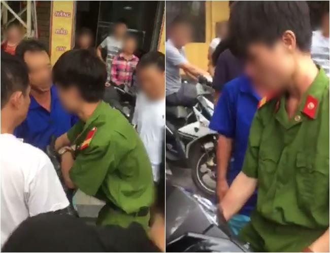 Công an xác minh thanh niên mặc quân phục, không đeo biển tên bị người dân vây đánh khi bắt xe vi phạm - ảnh 1