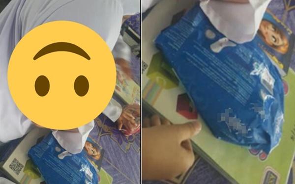 Bé gái tiểu học suốt ngày mang gói băng vệ sinh đến lớp, cô giáo sốc nặng khi thấy thứ bên trong - Ảnh 1.