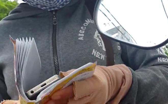 Màn kịch của cặp vợ chồng cầm iPhone 7 rởm lừa nữ công nhân - Ảnh 1.