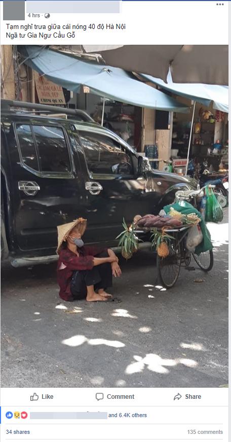 Hình ảnh bà cụ bán hàng rong ngồi nghỉ dưới bóng râm giữa cái nắng cháy da cháy thịt của Thủ đô khiến nhiều người thương cảm - Ảnh 1.