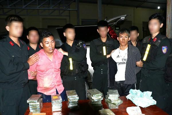 Phá chuyên án ma túy, bắt 2 đối tượng, thu 30 bánh heroin, 6000 viên ma túy tổng hợp - Ảnh 1.