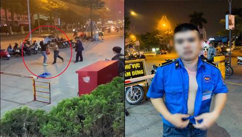 Phẫn nộ clip gã bảo vệ cởi trần vung tay đánh phụ nữ như đấm boxing ngay trên phố - Ảnh 1.