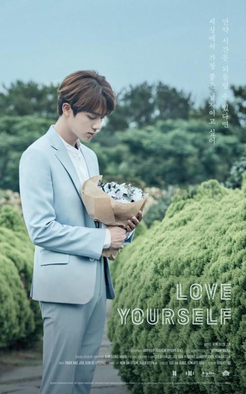 Jin cầm loài hoa không tồn tại trong ảnh nhá hàng mới của BTS - Ảnh 1.