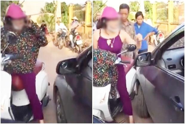Người phụ nữ cởi áo, chửi lái xe ô tô như
