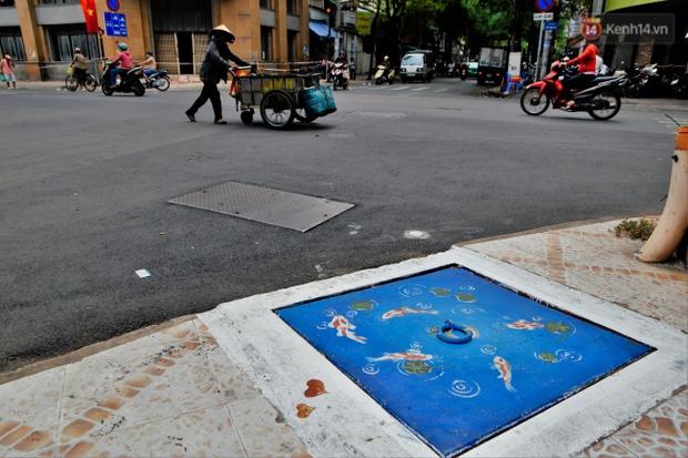 Nhìn những bức tranh trên nắp cống ở Sài Gòn đẹp như thế này, không ai nỡ xả rác nữa! - Ảnh 7.