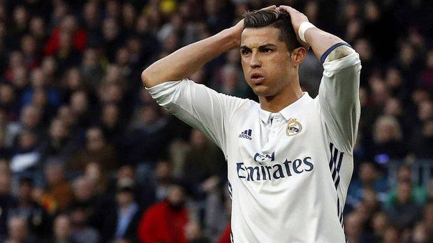 Ronaldo bị khiếu nại trốn thuế gấp 40 lần Messi - Ảnh 1.