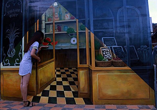Nhờ những bức tranh bích họa 3D phát sáng, làng chài nghèo được khoác lên mình diện mạo mới - Ảnh 11.