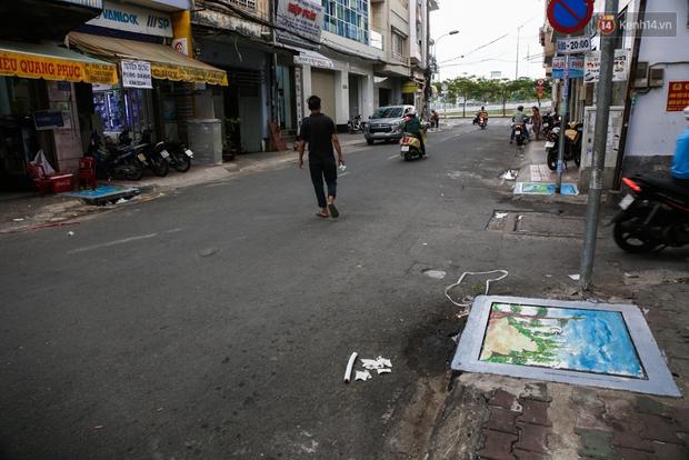 Nhìn những bức tranh trên nắp cống ở Sài Gòn đẹp như thế này, không ai nỡ xả rác nữa! - Ảnh 17.