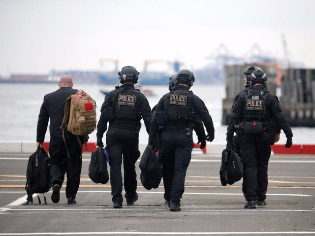 Cận cảnh Đội mật vụ bảo vệ Tổng thống Mỹ Donald Trump - Ảnh 14.