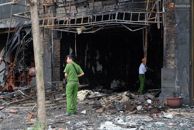 Hiện trường tan hoang sau vụ cháy quán karaoke trên đường Trần Thái Tông - Ảnh 13.