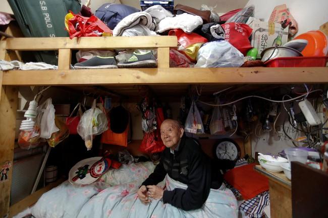 Chùm ảnh: Cuộc sống nghèo khổ phía sau những tòa nhà chọc trời và cuộc sống xa hoa ở Thượng Hải - Ảnh 7.