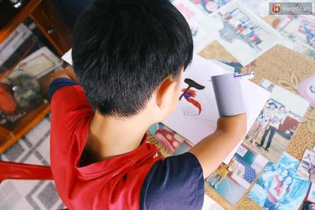 Cậu học trò nghèo gắn ống nhựa vào đôi tay cụt để vẽ ước mơ đời mình - Ảnh 5.