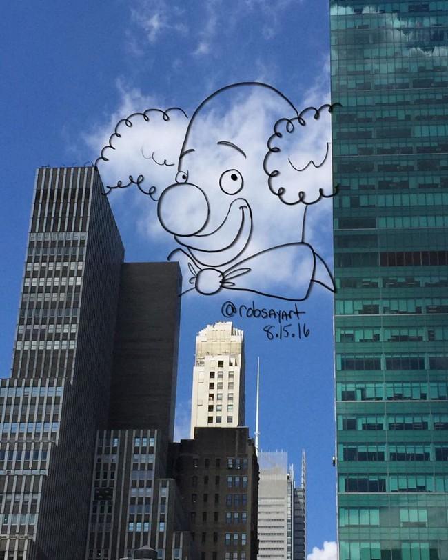 Họa sĩ vẽ tranh hoạt hình lên những đám mây - Ảnh 2.