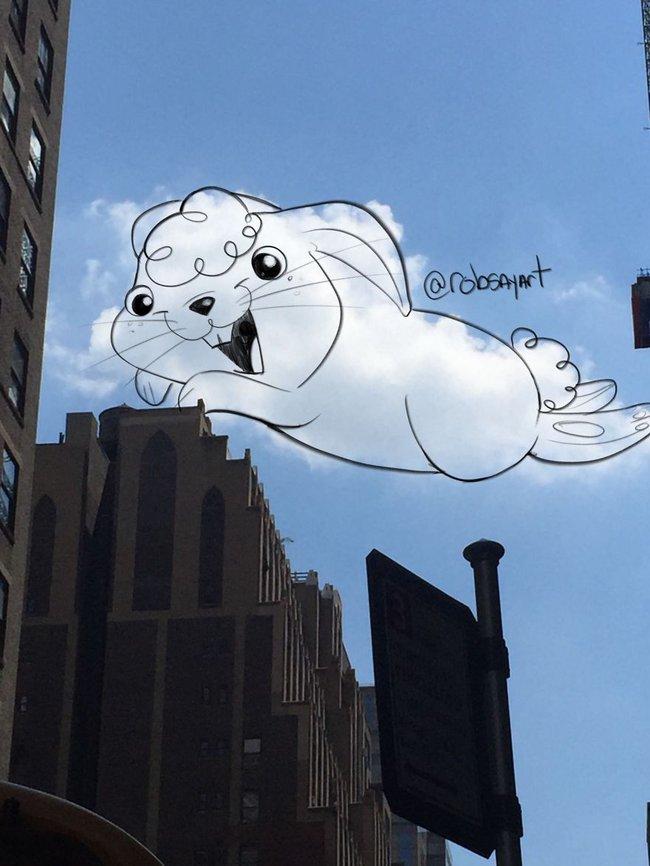 Họa sĩ vẽ tranh hoạt hình lên những đám mây - Ảnh 9.