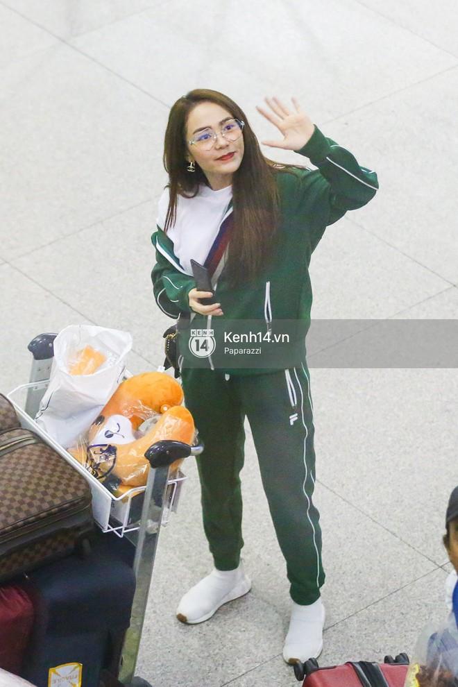 Diện đồ thể thao khoẻ khoắn, Minh Hằng nổi bật giữa sân bay lên đường đi Dubai tham dự tuần lễ thời trang quốc tế - ảnh 5