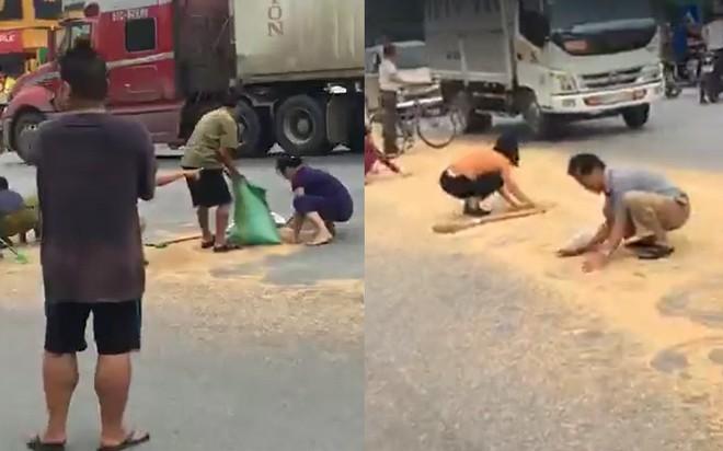 Hưng Yên: Xe chở lúa mỳ bị rơi vãi giữa quốc lộ 5, người dân bất chấp nguy hiểm chạy ra xúc hộ - ảnh 1