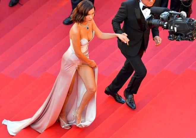Siêu mẫu Bella Hadid diện váy xẻ để lộ nội y trên thảm đỏ LHP Cannes - Ảnh 5.