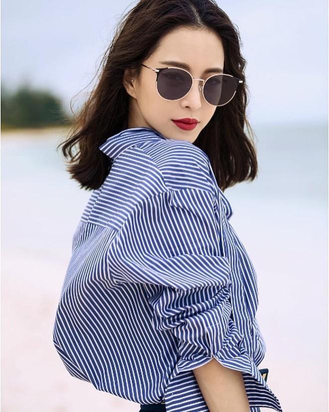 Có một kiểu áo sơ mi đang rất được lòng các sao nữ xứ Hàn: Diện lên trẻ trung, thu gọn vóc dáng và hơn thế nữa - ảnh 5