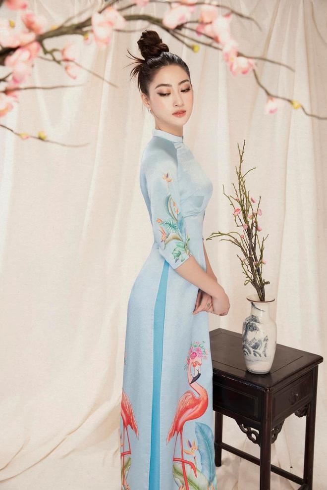 Bộ ảnh mới đong đầy sắc xuân của Lương Thuỳ Linh: Diện áo dài nền nã, túi búi cao khoe nhan sắc cực xinh đẹp! - ảnh 3