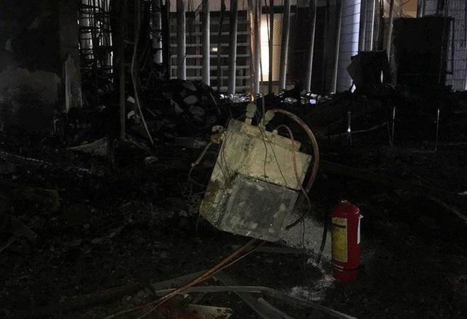 Hiện trường vụ cháy tòa nhà dầu khí Thanh Hóa khiến 2 người chết, 13 người bị thương - ảnh 8