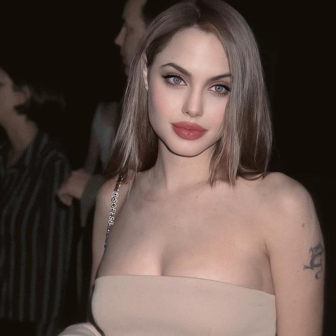 Dân tình đang náo loạn vì bộ ảnh Angelina Jolie ở thời kỳ đẹp nhất: Đẹp ngộp thở thế này bảo sao Brad Pitt mê, nhưng có gì đó sai sai - Ảnh 4.