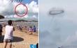 Người dân đi biển phát hiện chiếc vòng đen lơ lửng trên bầu trời, một lúc sau nó biến mất vào đám mây