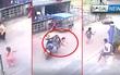 Bé gái đang chạy qua đường thì bất ngờ bị chiếc xe máy lao như tên bắn tông trúng
