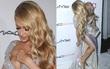 Paris Hilton suýt lộ ngực và vướng váy vào giày cao gót tại sự kiện