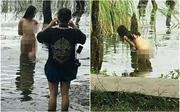 Cô gái trẻ khỏa thân hồn nhiên tạo dáng giữa hồ nước trong công viên