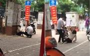 Hà Nội: Xôn xao clip cô gái bị chàng trai đánh gục trên phố Thái Hà nghi do ghen tuông