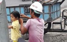 Hình ảnh đáng yêu nhất ngày: Người bố công nhân đứng tỉ mẩn cột tóc cho cô con gái nhỏ