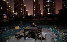 Chùm ảnh: Cuộc sống nghèo khổ phía sau những tòa nhà chọc trời và cuộc sống xa hoa ở Thượng Hải