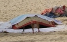 Thi thể cô gái không mặc quần, mặt biến dạng trôi dạt vào bờ biển