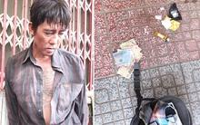 Con nghiện nhiễm HIV cầm kim tiêm dính máu tấn công cảnh sát
