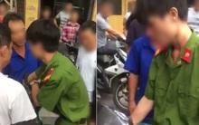 Nam thanh niên mặc quân phục bị người dân vây đánh giữa phố là công an nghĩa vụ