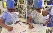 Nam y tá trẻ vừa địu bệnh nhi khóc ngằn ngặt vừa say sưa làm việc gây sốt mạng xã hội