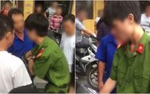 Công an xác minh thanh niên mặc quân phục, không đeo biển tên bị người dân vây đánh khi bắt xe vi phạm