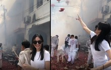 Người đẹp chuyển giới Nong Poy ném pháo vào đám đông trong lễ hội, cư dân mạng dậy sóng tranh cãi