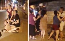 Xôn xao clip cô gái trẻ bị túm tóc đánh ghen ngay trên phố Hà Nội