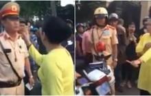 Chồng bị yêu cầu đưa ô tô về trụ sở vì vi phạm, vợ chống tay chửi bới, xúc phạm CSGT khiến nhiều người bức xúc