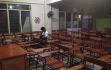 Cảm động hình ảnh nam sinh Philippines ở lại trường học bài đến tận tối muộn vì ở nhà nghèo không có điện