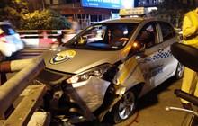 Hà Nội: Nam tài xế ngủ gật, xe taxi đâm vào thành cầu Chương Dương