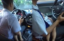 Xem ảnh nam tài xế taxi vừa lái xe vừa bế theo con nhỏ, dân mạng dù thương cũng không quên nhắc nhở